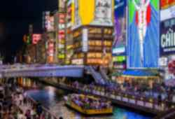 Explore the bustling streets of Osaka on a group tour in Japan