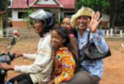 Local transport and smiling faces in Cambodia